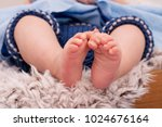 feets of little baby | Shutterstock . vector #1024676164
