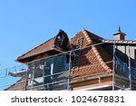 tiling a roof   Shutterstock . vector #1024678831