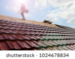 Tiling a roof - stock photo