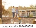 cheerful asian couple talking... | Shutterstock . vector #1024686331