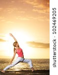 beautiful yoga woman at sunset | Shutterstock . vector #102469205