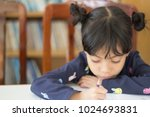 the adorable little asian girl... | Shutterstock . vector #1024693831