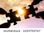 putting puzzle pieces together... | Shutterstock . vector #1024703767