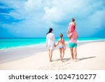 happy beautiful family of four... | Shutterstock . vector #1024710277