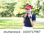 young asian woman playing golf... | Shutterstock . vector #1024717987