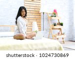 sexy asian woman sitting on bed ... | Shutterstock . vector #1024730869