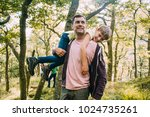 little boy is smiling at the... | Shutterstock . vector #1024735261
