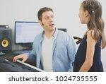 male vocal coach teaching...   Shutterstock . vector #1024735555