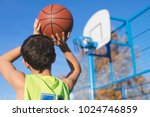 teenager throwing a basketball... | Shutterstock . vector #1024746859