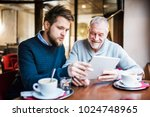 senior father and young son...   Shutterstock . vector #1024748965