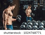 good looking young man lifting... | Shutterstock . vector #1024768771
