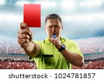 Referee showing the red card in ...