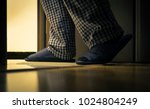 adult man in pijamas walks to a ... | Shutterstock . vector #1024804249
