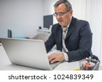 director works on a laptop | Shutterstock . vector #1024839349
