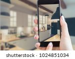 smartphone holds a hand in the...   Shutterstock . vector #1024851034