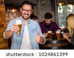 friends in the pub. drinking... | Shutterstock . vector #1024861399