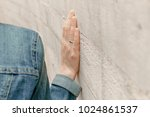 white woman hand touches the... | Shutterstock . vector #1024861537