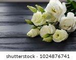 eustoma flowers on grey... | Shutterstock . vector #1024876741