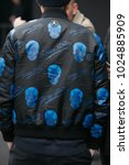 Small photo of MILAN - JANUARY 15: Man with Philipp Plein bomber jacket with blue skulls before Pal Zileri fashion show, Milan Fashion Week street style on January 15, 2018 in Milan.