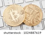 two golden bitcoin front and... | Shutterstock . vector #1024887619