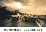 road accident in rainy highway | Shutterstock . vector #1024887811