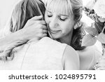 mom very emotionally embraces... | Shutterstock . vector #1024895791