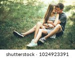 young couple lying on the grass ...   Shutterstock . vector #1024923391