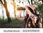 woman with binoculars and... | Shutterstock . vector #1024939855