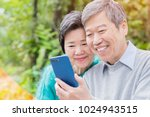 old couple use phone happily in ... | Shutterstock . vector #1024943515