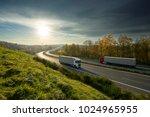trucks driving on the highway... | Shutterstock . vector #1024965955