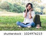 woman relax with headphones... | Shutterstock . vector #1024976215