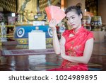 chinese woman wearing... | Shutterstock . vector #1024989895
