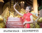 chinese woman wearing... | Shutterstock . vector #1024989955