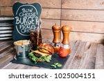 cheeseburger on a pretzel bun... | Shutterstock . vector #1025004151