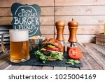 cheeseburger on a pretzel bun... | Shutterstock . vector #1025004169