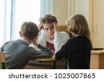 cute boy thinks about his move... | Shutterstock . vector #1025007865