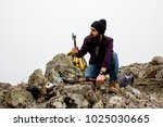 living conditions of man in... | Shutterstock . vector #1025030665