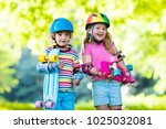 children riding skateboard in... | Shutterstock . vector #1025032081