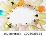 set of woman perfumes lying on... | Shutterstock . vector #1025035891