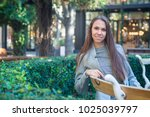 smiling happy woman sitting on... | Shutterstock . vector #1025039797