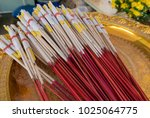 incenses sticks and candles  in ... | Shutterstock . vector #1025064775
