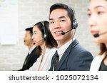 smiling male asian customer...   Shutterstock . vector #1025072134