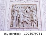 Small photo of Ornamental allegoric bas-relief marble sculpture with childrens playing on Peles castle wall in Sinaia, Romania