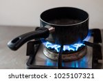 boiling water in pot with gas... | Shutterstock . vector #1025107321