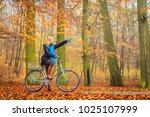 active woman riding bike... | Shutterstock . vector #1025107999