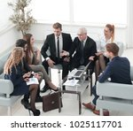business partners and business... | Shutterstock . vector #1025117701