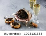 black caviar in silver bowl ... | Shutterstock . vector #1025131855