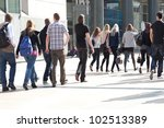 a crowd moving against a... | Shutterstock . vector #102513389