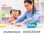 happy mother and daughter are... | Shutterstock . vector #1025135269