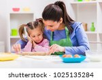 happy mother and daughter are... | Shutterstock . vector #1025135284